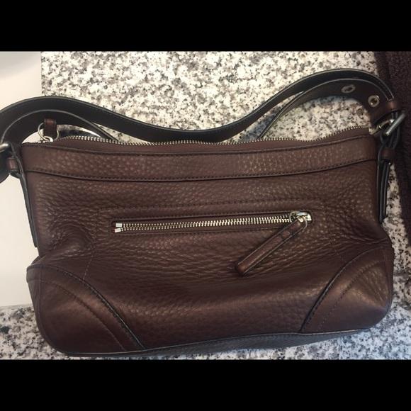 f558f2b5 Medium dark brown leather Coach purse